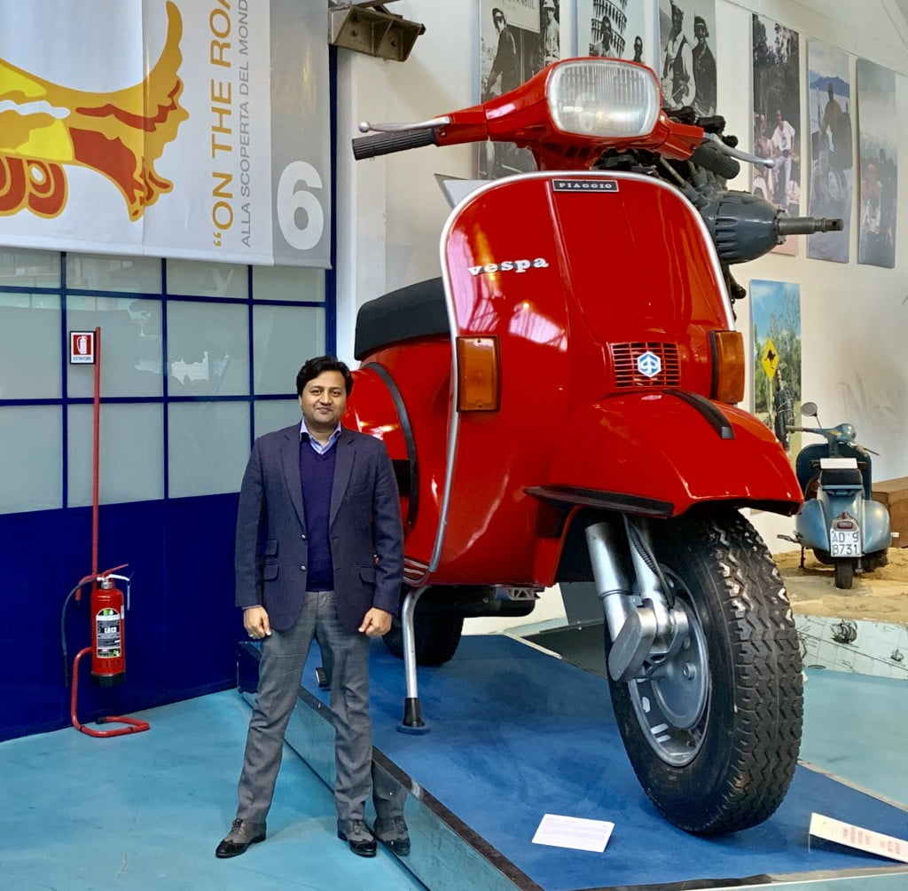 Vishal Singhal, Director, Advantek Fuel Systems in front of a scoter model