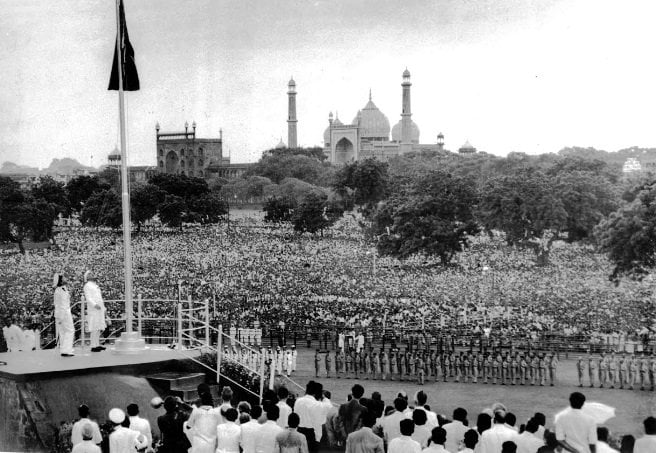 india past PM Jawaharlal Nehru Unfurling National Flag at Red Fort , Delhi