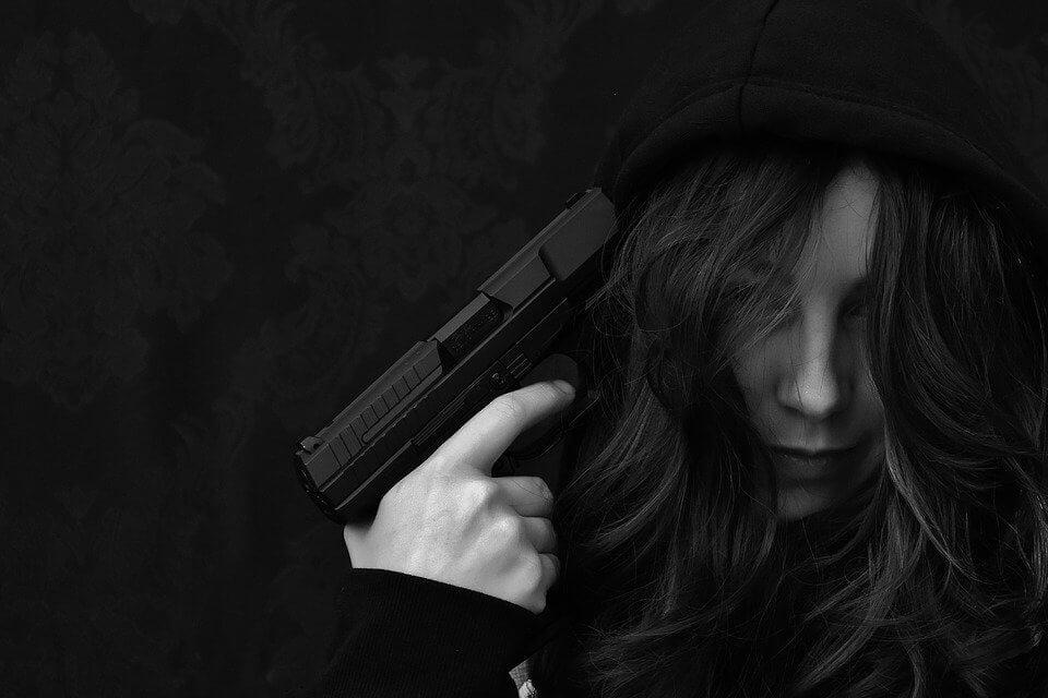 girl holding gun at her head
