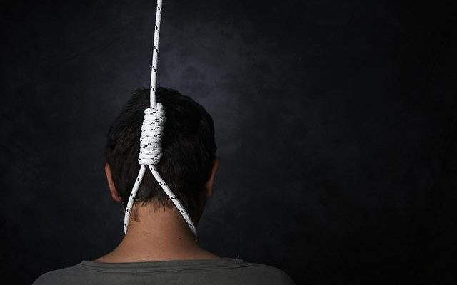 suicide rope with man's neck inside