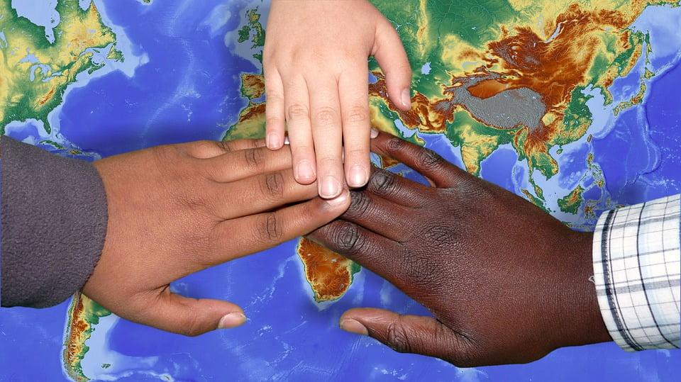migration multi racial hands