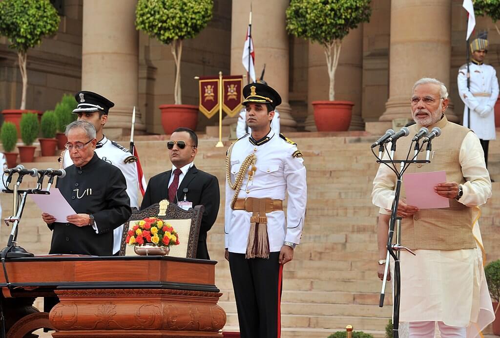 Narender Modi being administered oath as PM at Rashrapati Bhawan by President Pranab Mukherjee